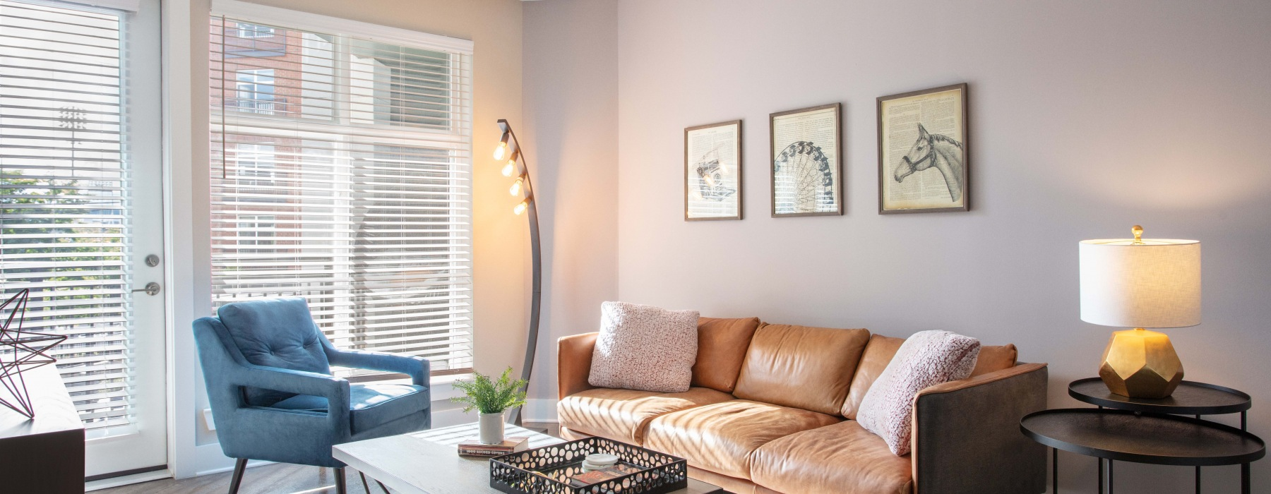 living room with couch, accent chair, coffee table and lots of natural light